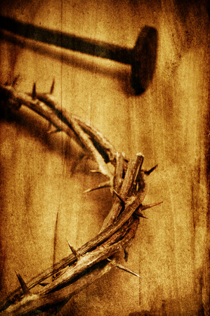 martyrdom: a nail and the Jesus Christ crown of thorns in the holy cross, with a retro filter effect