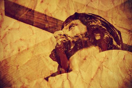 simbolos religiosos: una figura de Jesucristo portando la Santa Cruz, con un efecto retro