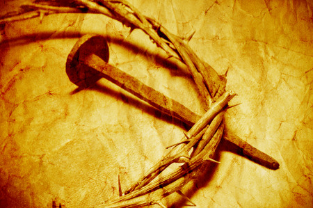 the passion of christ: a nail and the Jesus Christ crown of thorns, with a retro filter effect Stock Photo