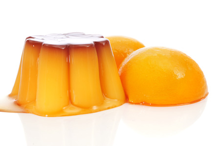 flavoured: creme caramel and peach in syrup on a white background Stock Photo