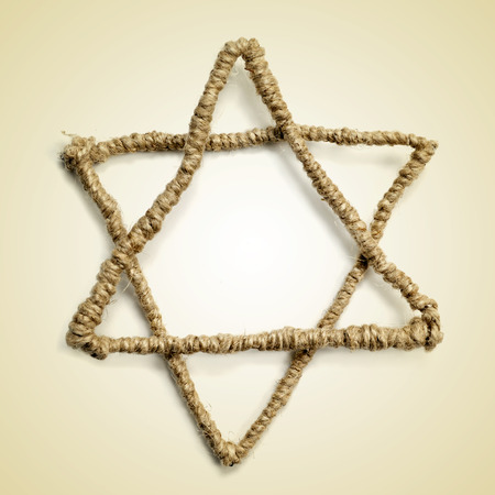 yiddish: a Star of David on a beige background with a retro effect Stock Photo