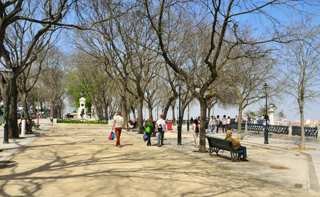 pedro de alcantara: LISBON, PORTUGAL - MARCH 17: People walking in Jardim de Sao Pedro de Alcantara on March 17, 2014 in Lisbon, Portugal. There is a panoramic view of the city from this public park