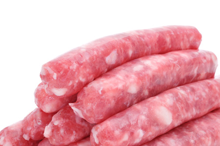 llonganissa: a pile of uncooked pork meat sausages on a white