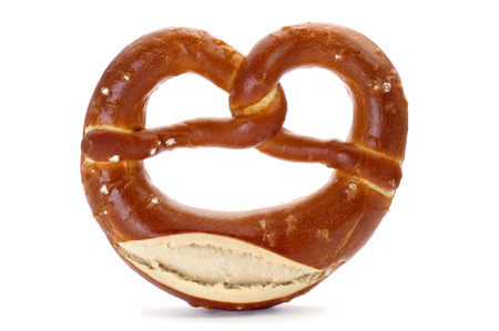 a laugenbrezel, a german pretzel, on a white background