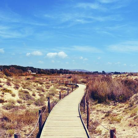 els: boardwalk in Els Muntanyans natural park in Torredembarra, Spain, with a retro effect
