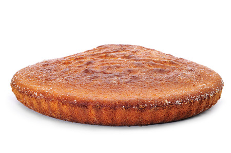 closeup of a sponge cake on a white background