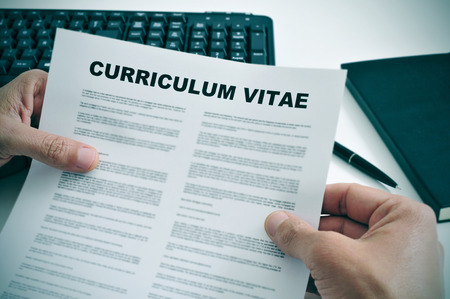 job qualifications: man in his office checking a curriculum vitae Stock Photo