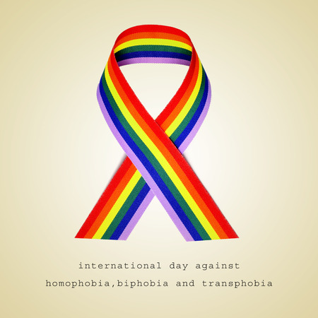 homophobia: a rainbow ribbon and the sentence international day against homophobia, biphobia and transphobia