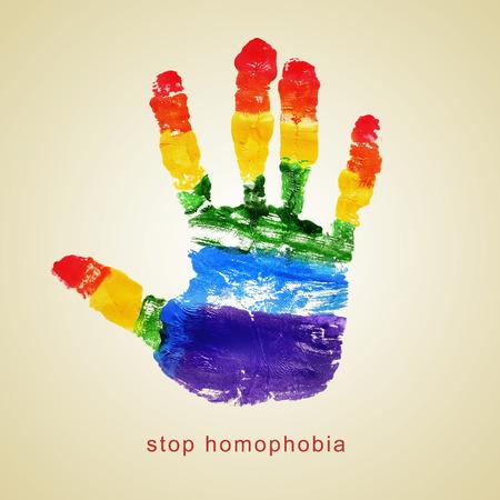 transexual: texto homofobia parada y una huella de la mano con los colores de la bandera del arco iris en un color beige