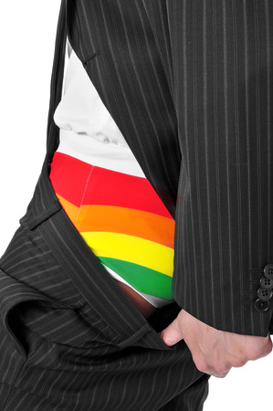 coming out: a businessman showing his rainbow underwear