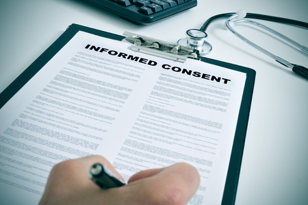 consent: patient signing an informed consent in a doctors office