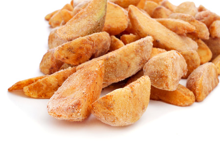 wedges: a pile of frozen home fries on a white background ready to fry