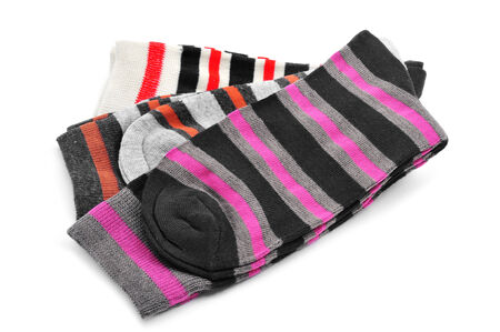 some pairs of stripped socks with different colors on a white background photo