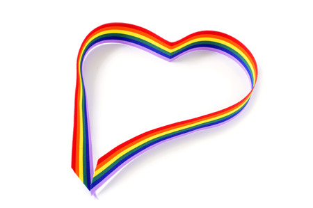 a rainbow ribbon forming a heart on a white background photo