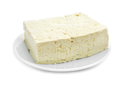 firm: a block of tofu in a plate on a white background Stock Photo