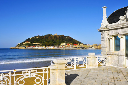 san sebastian: a view of La Concha Beach in San Sebastian, Spain, with the Urgull Hill in the background