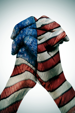 man clasped hands patterned with the american flag photo
