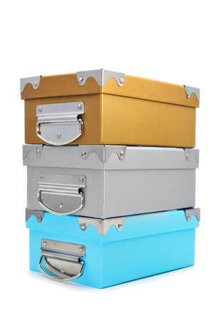 filing: a pile of cardboard storage boxes with different colors and with metal handles on a white