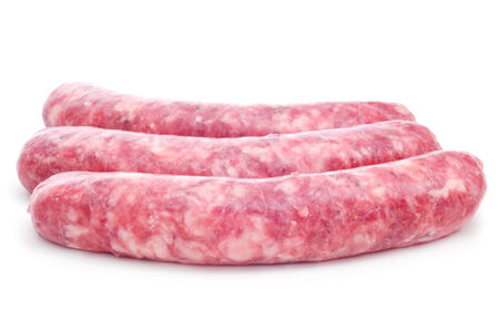 llonganissa: a pile of uncooked pork meat sausages on a white Stock Photo