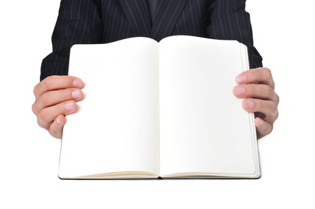 a businessman showing a notebook with blank pages photo