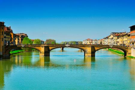 trinita: Florence, Italy - April 15,m 2013  Ponte Santa Trinita bridge and Arno River in Florence, Italy  This Renaissance bridge is the oldest elliptic arch bridge in the world