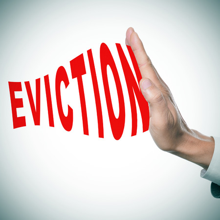 eviction: man hand stopping the word eviction Stock Photo
