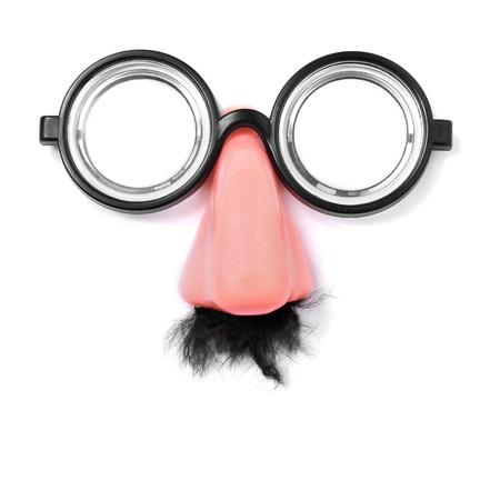 fake short-sighted glasses, nose and moustache forming a face on a white background photo
