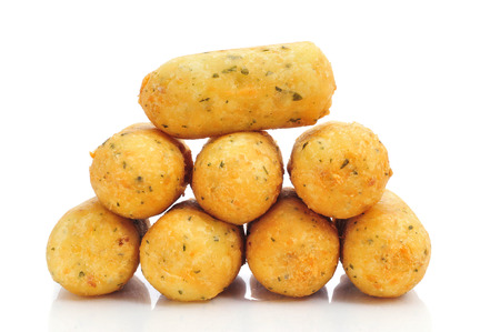 croquettes: a pile of croquetas de bacalao, spanish codfish croquettes, on a white background