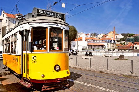 electrico: Lisbon, Portugal - March 18, 2014  A typical tram 28 in Alfama district in Lisbon, Portugal  The 28 line is one of the most used by tourists, because it connects Baixa and Alfama districts