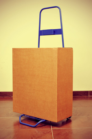 dolly bag: a heavy package in a hand truck, with a retro filter effect