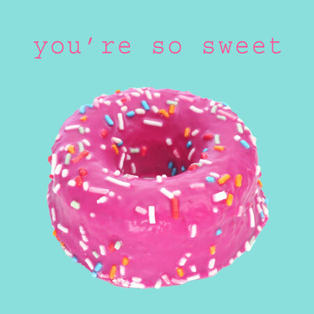 a colorful donut on a blue and the sentence you are so sweet photo