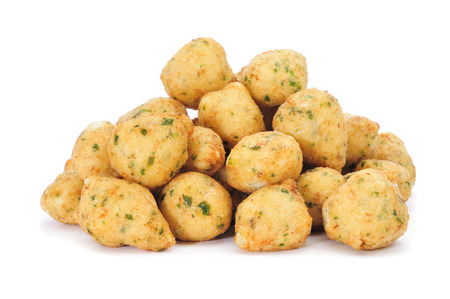 bacalao: a pile of bunuelos de bacalao, spanish cod fritters, on a white