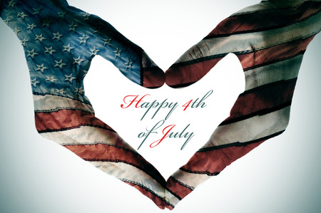 man hands patterned with the flag of the United States forming a heart and the sentence happy 4th of july Stock Photo