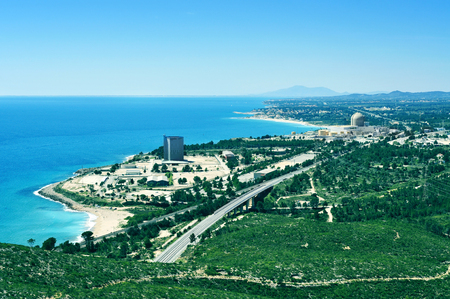 decommissioning: Vandellos, Spain - May 4,m 2014  Aerial view of the coastline and the nuclear power station in Vandellos, Spain  One of the two nuclear reactors of the plant was shut down on 1990