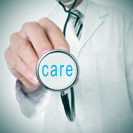health check: doctor with a stethoscope with the word care written in it