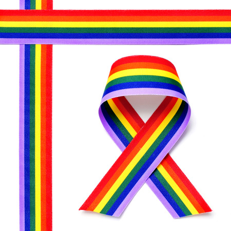 crossed rainbow ribbons and awareness ribbon on a white background photo
