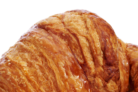 closeup of an appetizing croissant on a white background photo