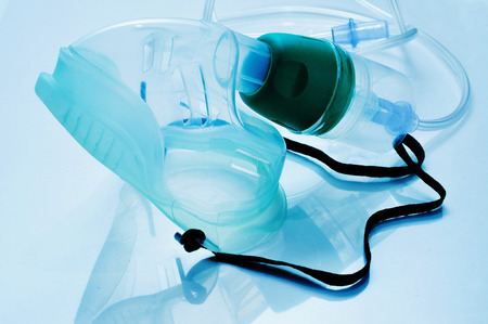 breathlessness: closeup of a medical oxygen mask Stock Photo