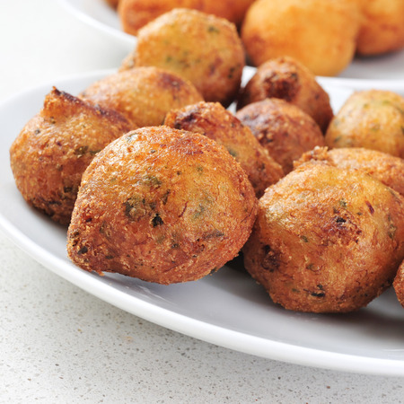 bacalao: closeup of a plate with bunuelos de bacalao, spanish cod fritters