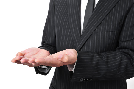 poorness: man wearing a suit with his hands open, as begging or showing or holding something