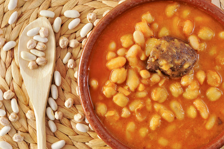 potage: an earthenware bowl with potaje de judias y garbanzos, a traditional spanish legume stew