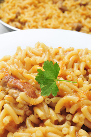 cazuela: closeup of a plate with fideos a la cazuela, spanish noodles with chicken or pork Stock Photo