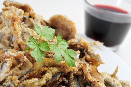 engraulis encrasicolus: a plate with some spanish boquerones fritos, fried anchovies typical in Spain, served as tapas Stock Photo