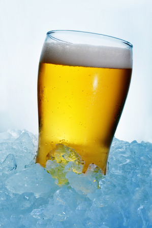 pilsner beer: closeup of a refreshing glass of beer on crushed ice