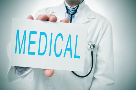 geriatrician: a doctor showing a signboard with the word medicine written in it