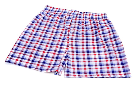 underclothing: checkered boxer shorts on a white background Stock Photo