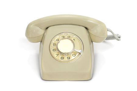 rotary dial telephone: beige viejo tel�fono de disco en un fondo blanco
