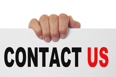 advertise with us: man hand holding a signboard with the text contact us written in it
