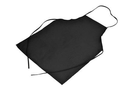 delantal: un delantal de cocina negro sobre un fondo blanco Foto de archivo