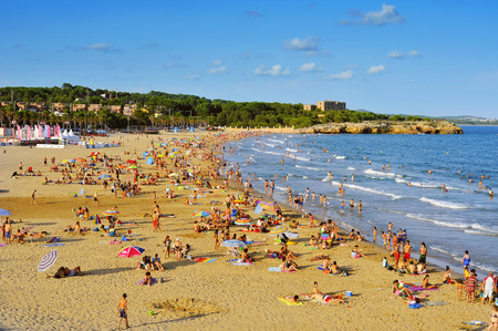 vacationers: Tarragona, Spain - August 5, 2014  Vacationers in Arrabassada Beach in Tarragona, Spain  Tarragona, in the famous Costa Daurada, has several urban beaches like this, frequented by local